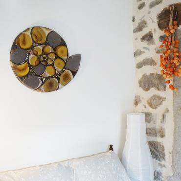 Wall hanging yellow and black ammonite in enamelled lava