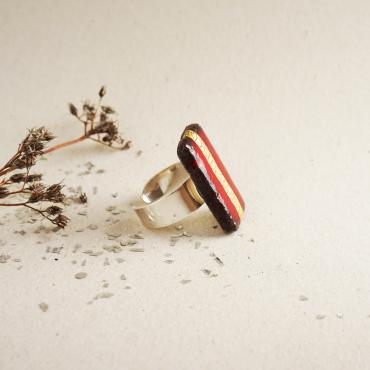 Red rectangular ring in enamelled lava and gold touches