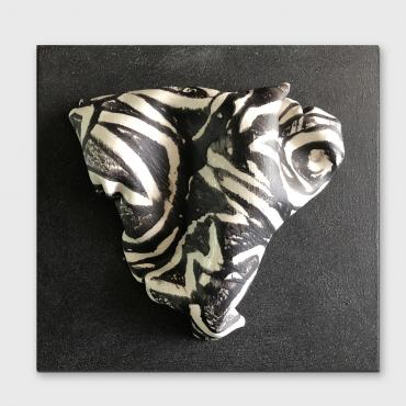 Bas relief heart in black and white porcelain