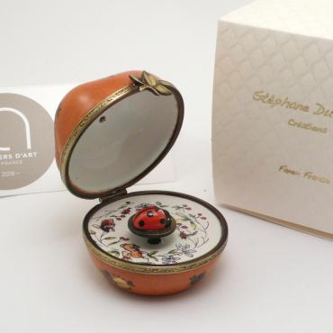 Music box pomme orange