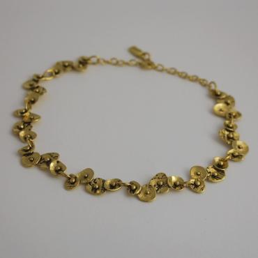 Adjustable necklace in golden tin