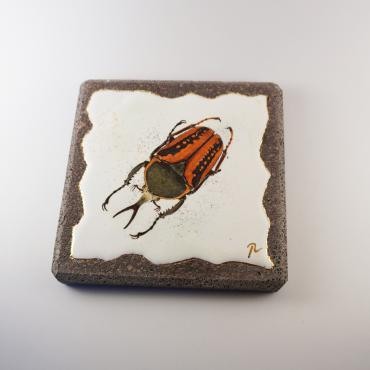 Coasters orange insect in enamelled lava