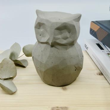 Owl in grey concrete