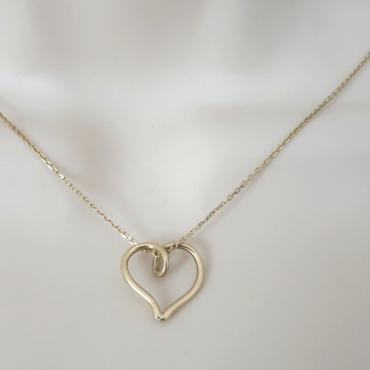 Pendant mini-heart in yellow gold
