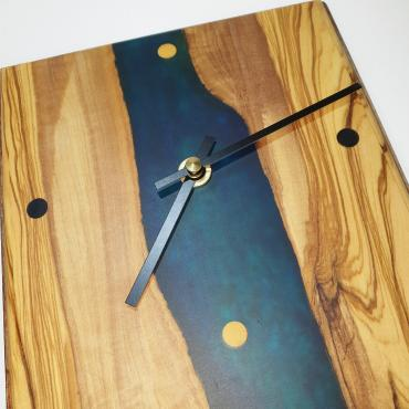 Wall clock in olivewood and resin