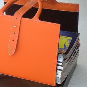 Leather magazine rack orange