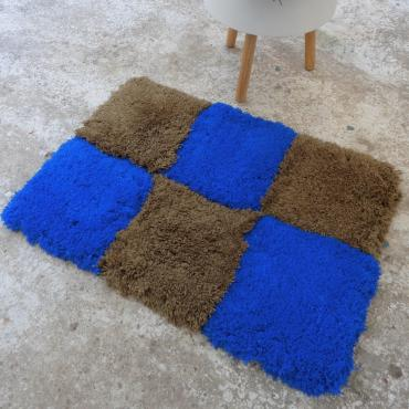 Small brown carpet cushion