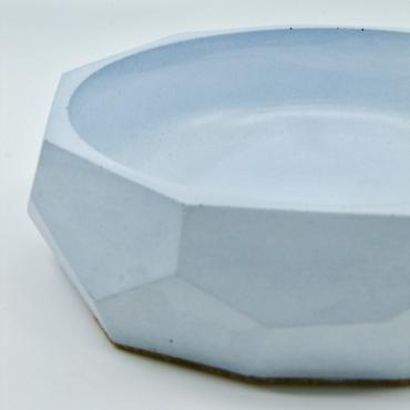 Trinket bowl faceted in blue concrete