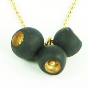Collier Cocon noir et or